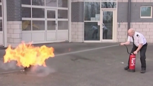 Large image of a fire warden using a fire extinguisher as part of fire warden training in education