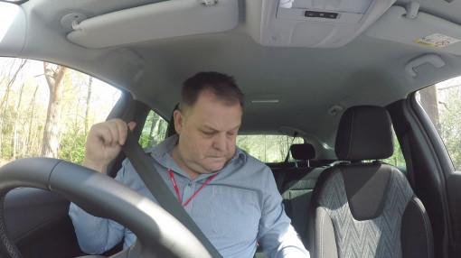 A man putting his seatbelt on