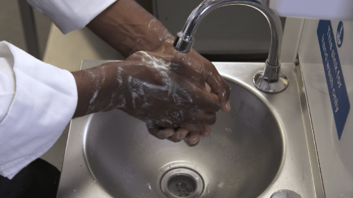 Someone washing their hands