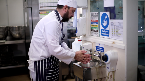 A chef washing his hands.